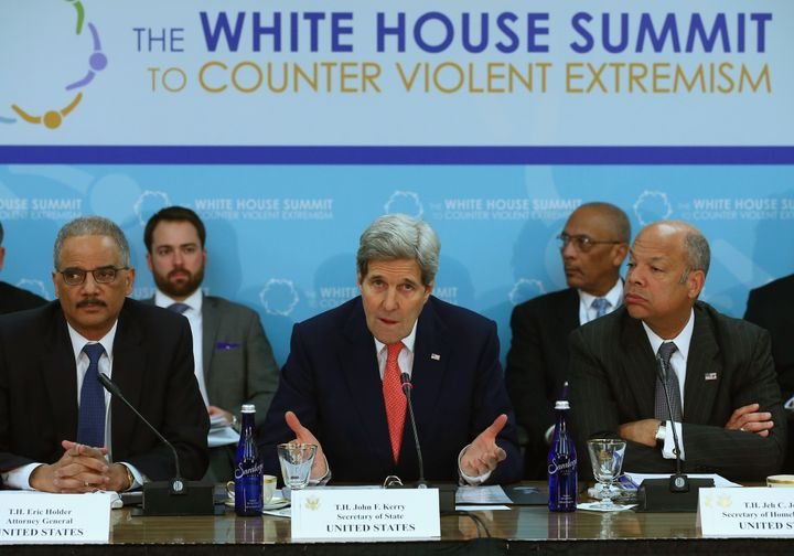 Secretary of State John Kerry, former Attorney General Eric Holder and Homeland Security Secretary Jeh Johnson speak at the W