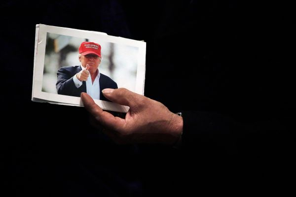 A man holds a picture of Republican presidential candidate Donald Trump at the rope line during a campaign event at the U.S.