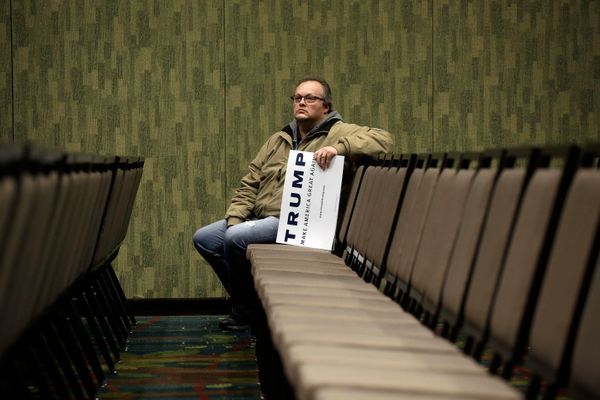 Tim Willard holds a campaign sign during a campaign event for Republican presidential candidate Donald Trump at the U.S. Cell
