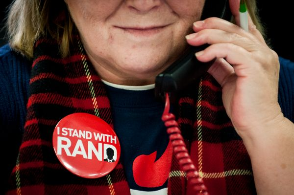 A volunteer makes calls to potential Rand Paul voters at his Des Moines headquarters on February 1, 2016 in Des Moines, Iowa.