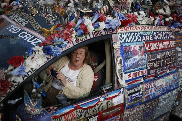 Political activist Lynda Farley, who calls herself 'Smoking Granny', sits for a photograph in her minivan outside an event fo
