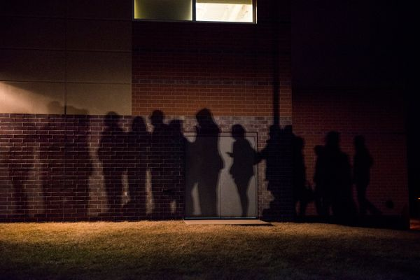 WEST DES MOINES, IA -  FEBRUARY 1:  The shadows of caucus goers lined up outside a Democrat Party caucus can be seen on the w