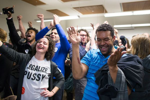Supporters of Democratic presidential candidate Sen. Bernie Sanders (I-Vt.) celebrate as Sanders wins precinct 47 with a vote