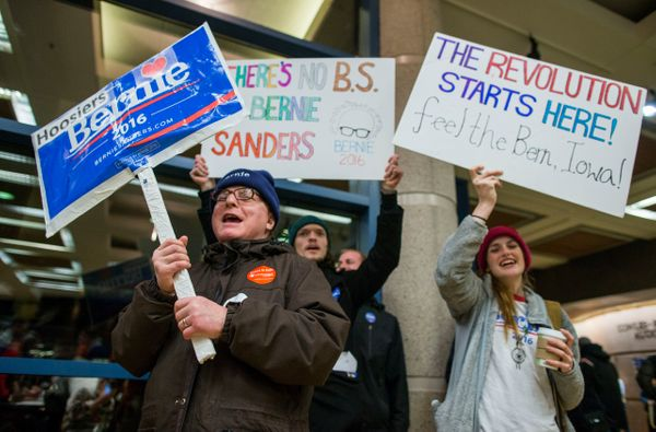 Supporters cheer before the start of caucus night at the State Historical Society of Iowa, on Monday in Des Moines, Iowa. Pre