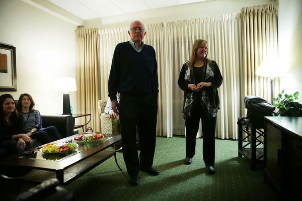Democratic presidential candidate Sen. Bernie Sanders (I-VT) (2nd R) waits for caucus results with his wife Jane O'Meara Sand