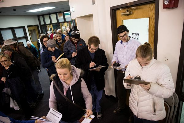 IOWA, USA - FEBRUARY 1:  Iowans register to cast their ballot in the 2016 Iowa Caucus at one of three precincts in Ames High