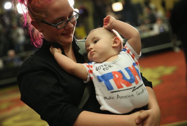 Hayley Kibbe holds her 8-month-old son Beau at Republican presidential candidate Donald Trump's Iowa Caucus night gathering F