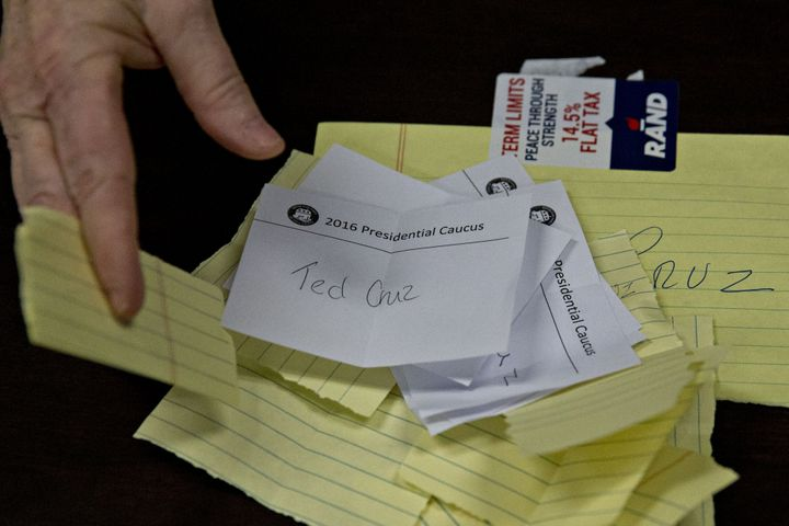 Paper ballots for Senator Ted Cruz are dispersed during the first-in-the-nation Iowa caucus in the Brody Middle School cafete