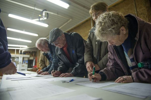 Caucus attendees sign in as they arrive at a Democratic Party Caucus at Jackson Township Fire Station on February 1, 2016 in