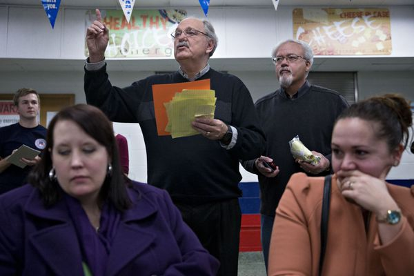 Ballot tallies are announced during the first-in-the-nation Iowa caucus in the Brody Middle School cafeteria in Des Moines, I