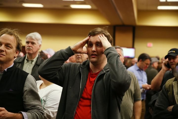 Robert Montgomery reacts to caucus return numbers at the Donald Trump for President Caucus Watch Party at the Sheraton Hotel