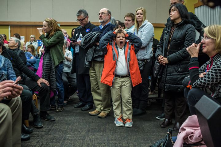 Federico Oliphant, age 8, yawns during the Democratic party caucus in precinct 317 at Valley Church on Feb. 1, 2016 in West D