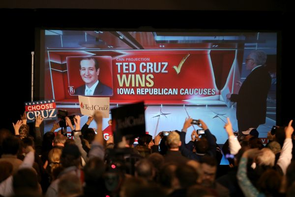 People cheers as Republican presidential candidate Sen. Ted Cruz (R-TX) is declared the winner at the caucus night gathering