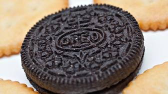 Kraft Foods Inc. brand Oreo cookies and Ritz crackers are displayed for a photograph in New York, U.S., on Monday, Nov. 9, 2009. Kraft Foods Inc., the maker of Oreos and Ritz crackers, stuck to its initial bid in an unsolicited offer to buy Cadbury Plc for 9.8 billion pounds ($16 billion) that may make it the world's largest confectioner. Photographer: Daniel Acker/Bloomberg