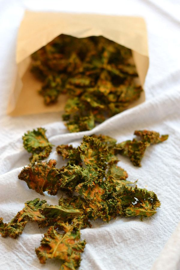 """<strong>Get the <a href=""""http://theearthentable.com/2014/09/kale-chips/"""" target=""""_blank"""">Cheesy Garlic Kale Chips recipe</a>"""