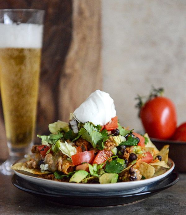 """<strong>Get the <a href=""""http://www.howsweeteats.com/2013/04/20-minute-turkey-taco-nachos/"""" target=""""_blank"""">20-Minute Turkey"""