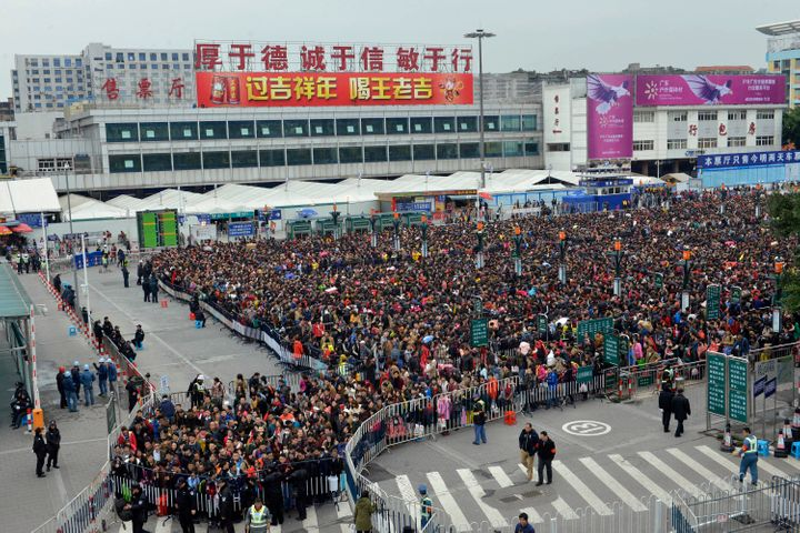 Nearly 100,000 travelers filled the gates outside the railway station in Guangzhou on Feb. 1, one week before the Chines