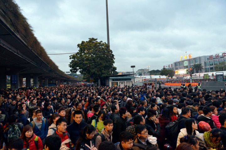 Icy weather has delayed several trains in China, stranding nearly 100,000 people in Guangzhou who were headed home for tradit