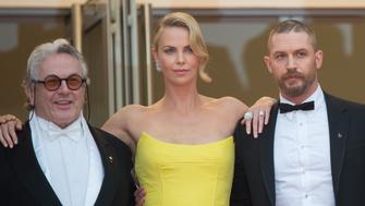 CANNES, FRANCE - MAY 14:  George Miller, Charlize Theron and Tom Hardy attend the 'Mad Max : Fury Road'  Premiere during the 68th annual Cannes Film Festival on May 14, 2015 in Cannes, France.  (Photo by Samir Hussein/WireImage)