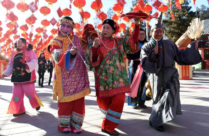 Folk artists rehearse for a upcoming temple fair to celebrate the Chinese Lunar New Year.