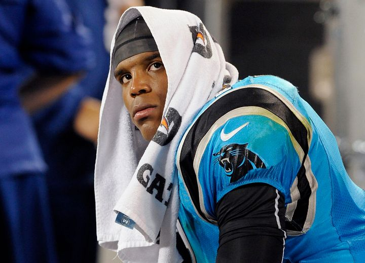 Carolina Panthers quarterback Cam Newton sits on the team's bench frustrated late in fourth quarter action against the New Yo
