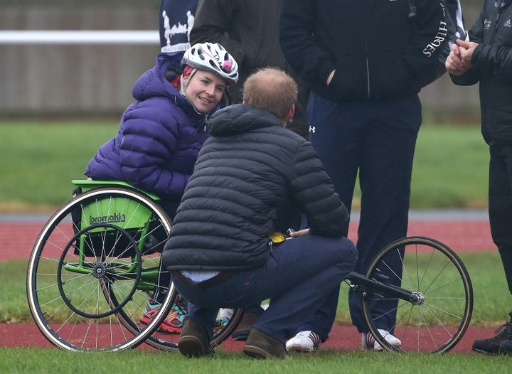 Prince Harry, talking to Pollock on the track