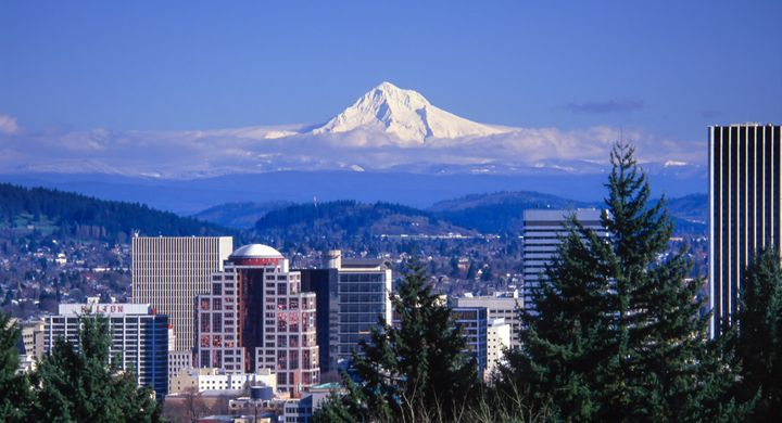 Snow-covered Mt. Hood looms over buildings in downtown Portland, Oregon.