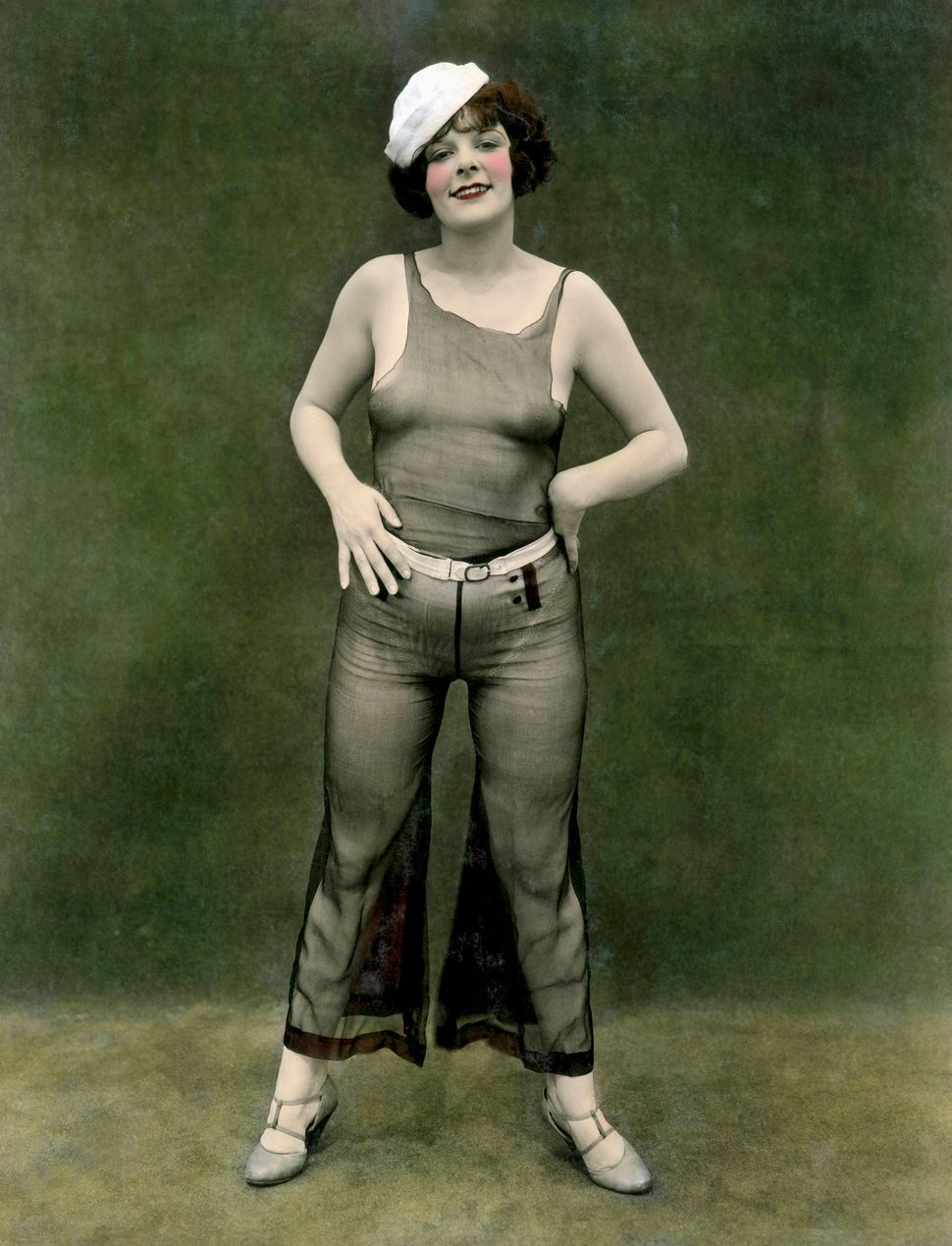 """Titled """"A Little Salt,"""" this pin-up woman in a sheer outfit and a sailor cap looks the part in 1930."""