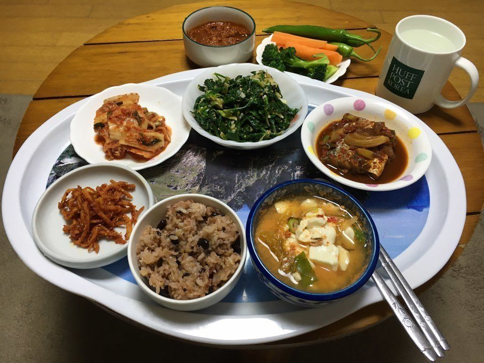 """Families in Korea usually eat a bowl of rice and soup along with 2 to 6 side dishes. A lot of those are left-overs from the"