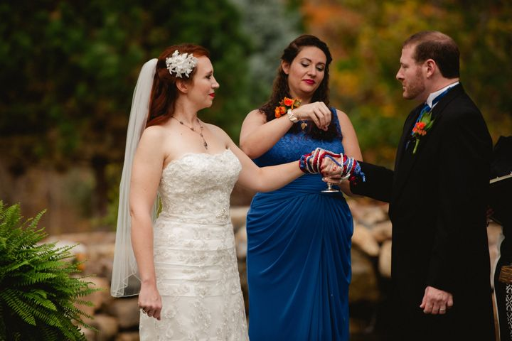 "Courtney Weber's bridesmaid Tiffany Spaulding, blesses the union with water ""for energies of love,"" Weber said. ""The water ca"