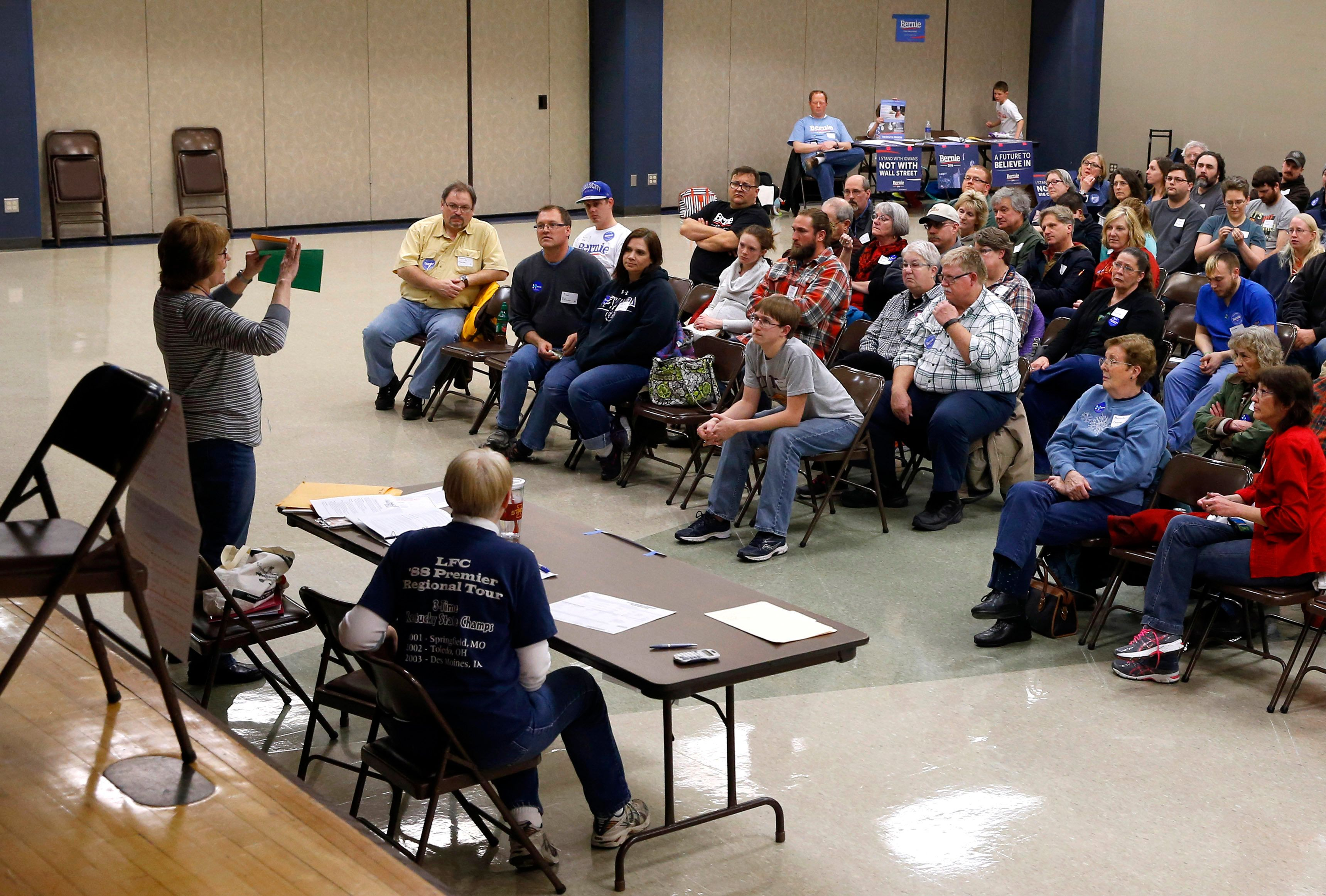 Voters listen to instructions during a Democratic party caucus in Nevada, Iowa, Monday, Feb. 1, 2016. (AP Photo/Patrick Semansky)