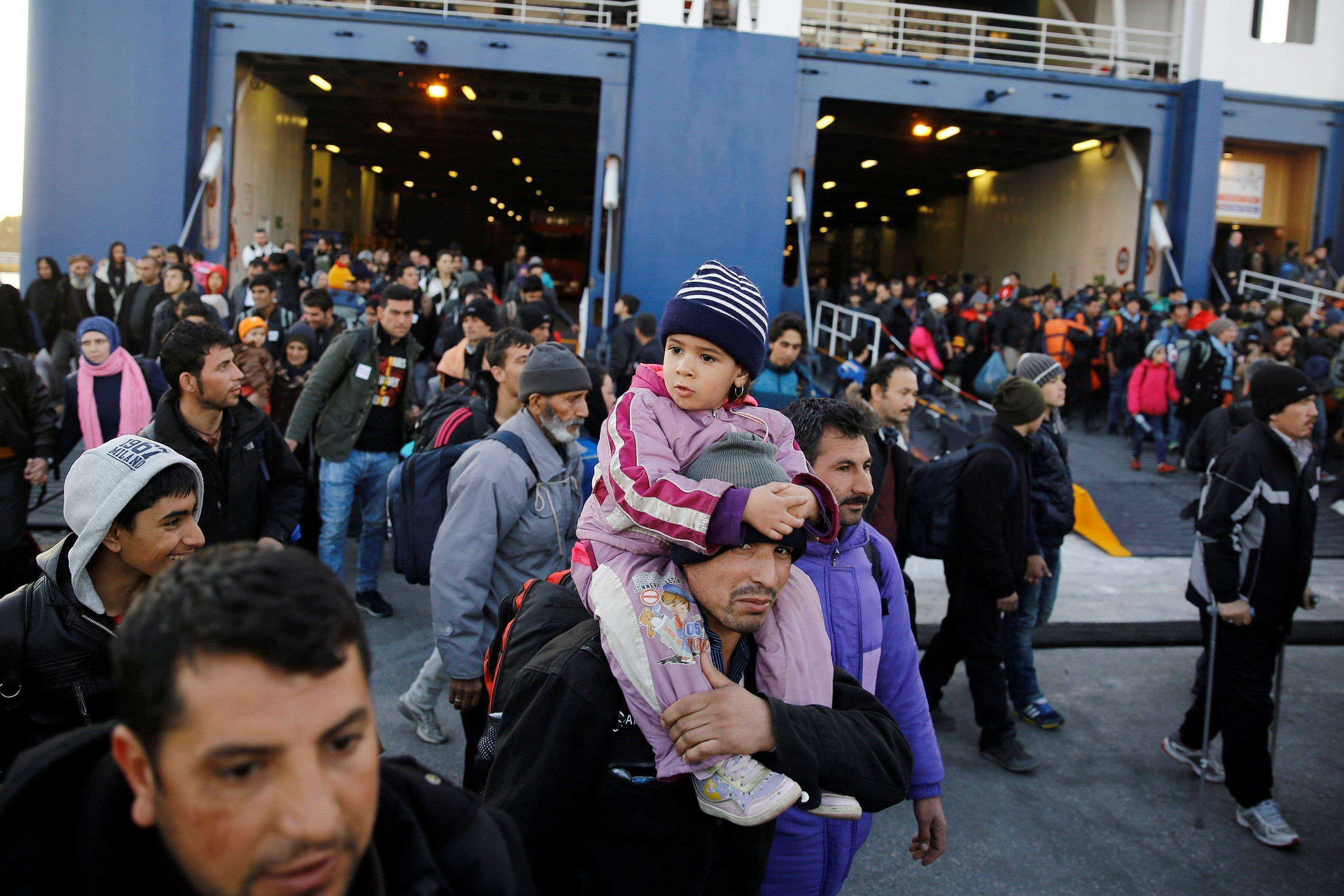 Syrian refugees arrive inPiraeus inpassenger ships from Athens chartered by the Greek government.Greece is