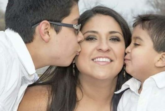 Lesly Sophia Cortez-Martinez poses for a photo with two of her children.