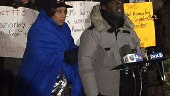 Constance Malcolm, left, and Frank Graham, right, speak at a press conference outside the office of U.S. Attorney Preet Bharara early the morning of Feb. 3, 2016. Their 18-year-old son, Ramarley Graham, was killed by an NYPD officer in 2012.