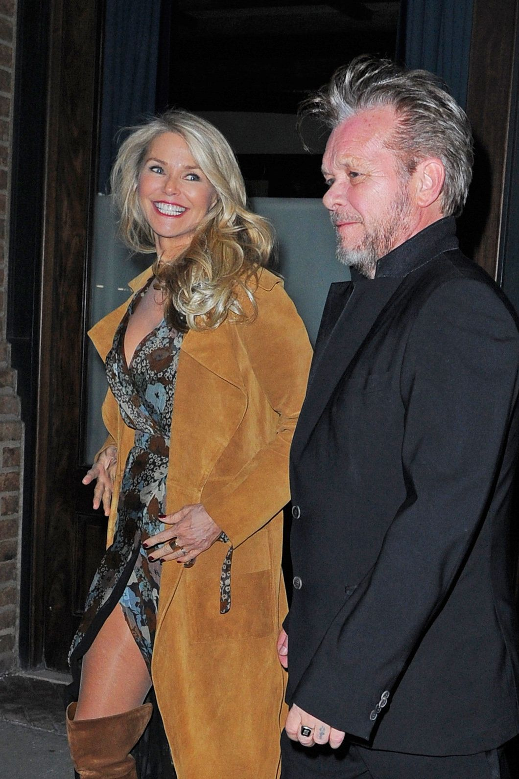 NEW YORK - FEBRUARY 02: Christie Brinkley and John Mellencamp step out of there Tribeca hotel on February 02, 2016 in New York, New York.  (Photo by Josiah Kamau/BuzzFoto via Getty Images)
