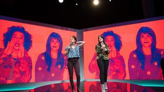 NEW YORK, NY - MAY 20:  Ilana Glazer (L) and Abbi Jacobson, actresses from the Comedy Central show Broad City speak onstage during the Spotify press announcement on May 20, 2015 in New York City.  (Photo by Noam Galai/WireImage)