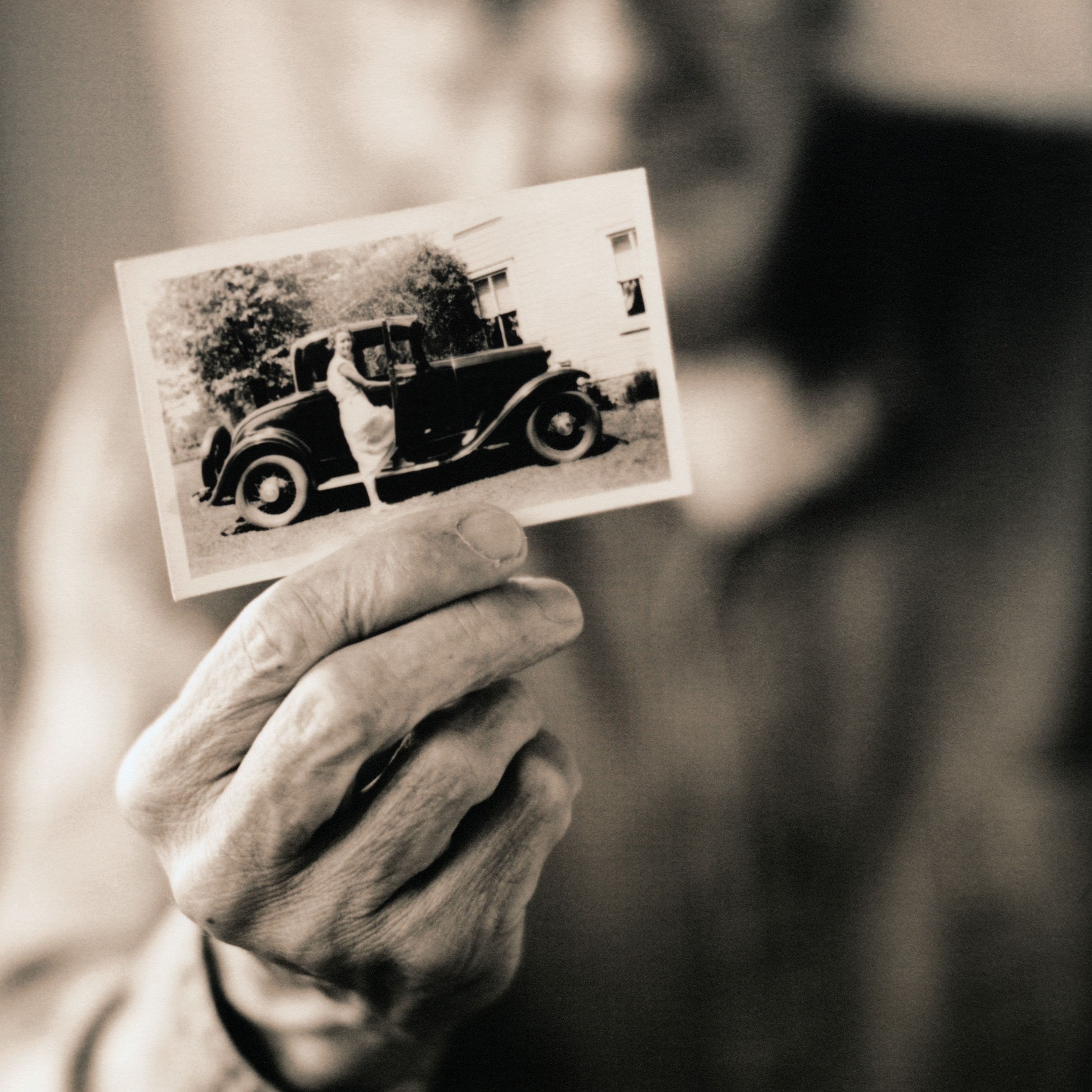 Man Holding a Vintage Photograph