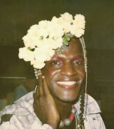 "<a href=""http://www.outhistory.org/exhibits/show/tgi-bios/marsha-p-johnson"" target=""_blank"">Johnson</a> was an outspoken and"