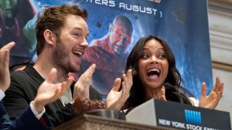NEW YORK, NY - JULY 29:  Chris Pratt (2nd L) and Zoe Saldana ring the opening bell at the New York Stock Exchange on July 29, 2014 in New York City.  (Photo by D Dipasupil/FilmMagic)