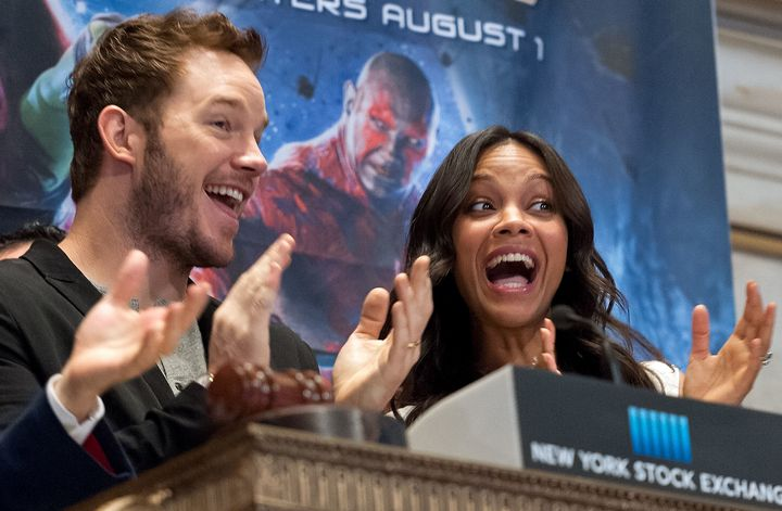 Chris Pratt and Zoe Saldana ring the opening bell at the New York Stock Exchange on July 29, 2014 in New York City. (Photo by
