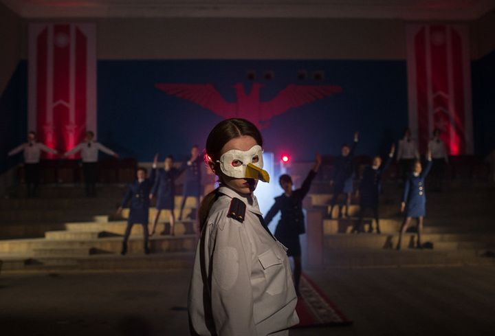 """A still from the music video shows a band member in a seagull mask. The visual is symbolic, as """"Chaika"""" translates to """"seagul"""