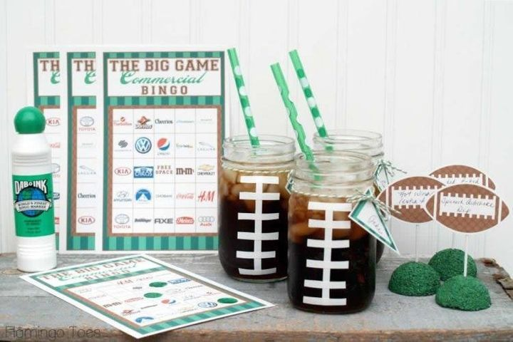 "Master this adorable DIY by <a href=""http://www.flamingotoes.com/2014/01/big-game-party-ideas-giveaway/"" target=""_blank"">Flamingo Toes</a> by using tape to create football laces for your mason jars."