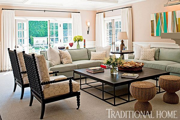 The family room, complete with two pale green sofas and a pair of elegant armchairs, is the ideal gathering place for lo