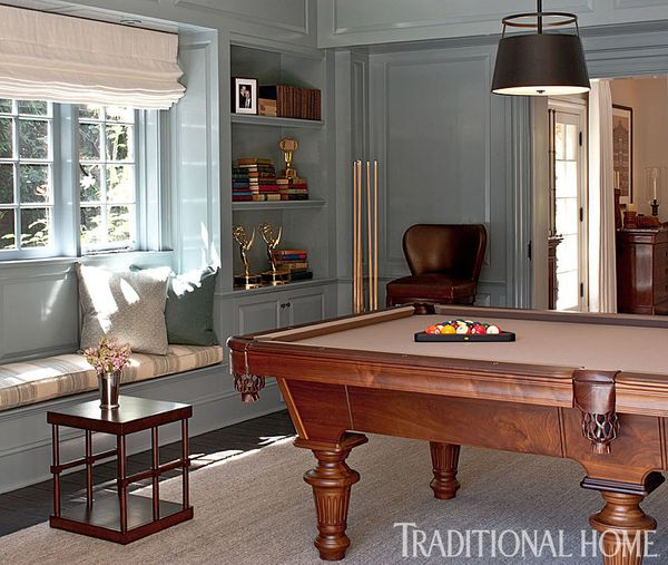 The billiards room is another place the couple can host casual hangouts. The blue-grey paint sets a