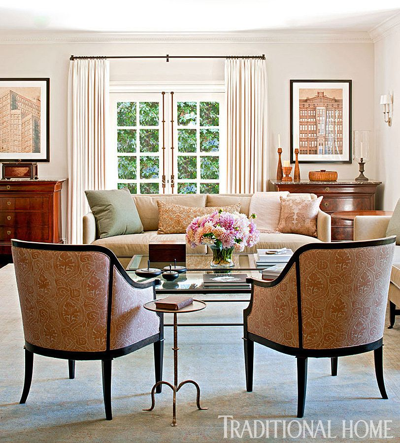 The living room's neutral color scheme and antique furniture pieces elevate the space without making things stuffy.