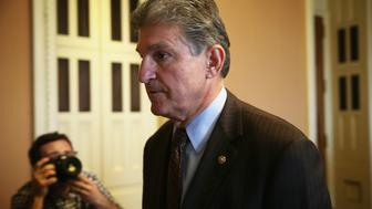 WASHINGTON, DC - NOVEMBER 13:  U.S. Sen. Joe Manchin (D-WV) leaves after a Democratic Senate leadership election at the U.S. Capitol November 13, 2014 in Washington, DC. U.S. Senate Democratice Leader Sen. Harry Reid (D-NV) was re-elected as the leader in the election. He also included Sen. Elizabeth Warren (D-MA), Sen. Jon Tester (D-MT) and Sen. Amy Klobuchar (D-MN) in the new leadership team with new positions.  (Photo by Alex Wong/Getty Images)