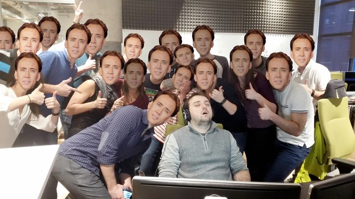 Guy Who Fell Asleep At Work surrounded by Nicholas Cages.