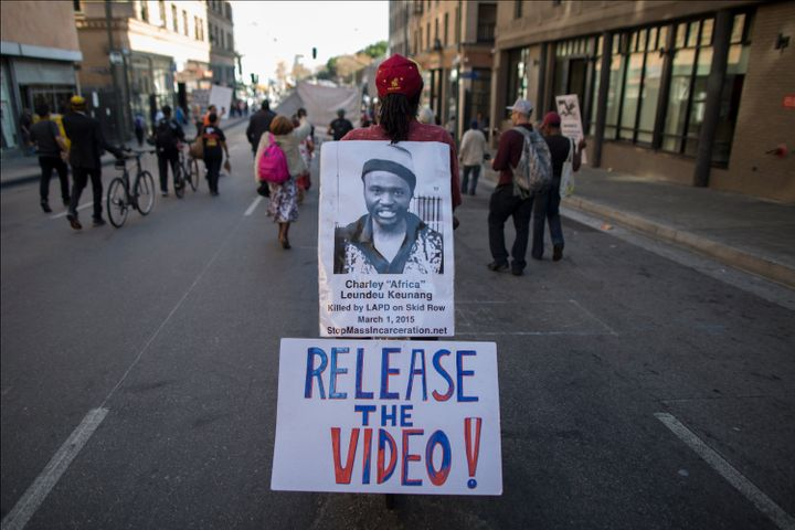 A protester last October calls for release of Los Angeles police video of Charly Keunang's death.