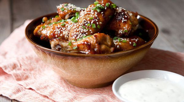 """<strong>Get the <a href=""""http://www.macheesmo.com/sticky-chicken-wings/"""" target=""""_blank"""">Chili Garlic Sticky Wings recipe</a>"""