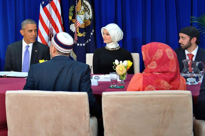 Obama participates in a roundtable discussion with members of the Muslim community while visiting the Islamic Society of Balt